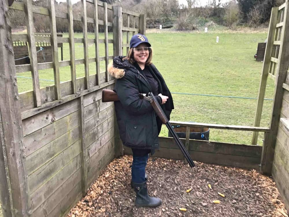Muddy Berkshire editor Rachel jane in Royal Berkshire Shooting School cap, safety glasses and a gun