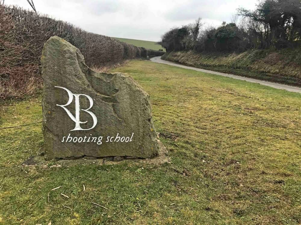Large stone with Royal Berkshire Shooting School logo on it entrance West Berkshire