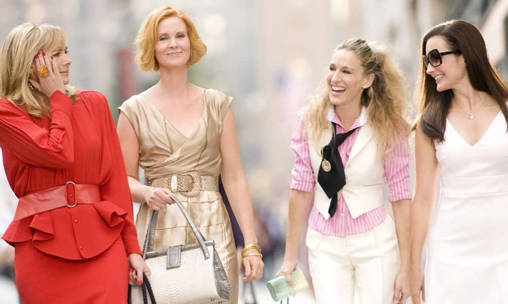 Sex and the City girls Carrie, Miranda, Samantha and Charlotte walking streets of New York