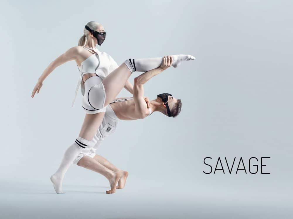 Futuristic dancers wearing white with face masks