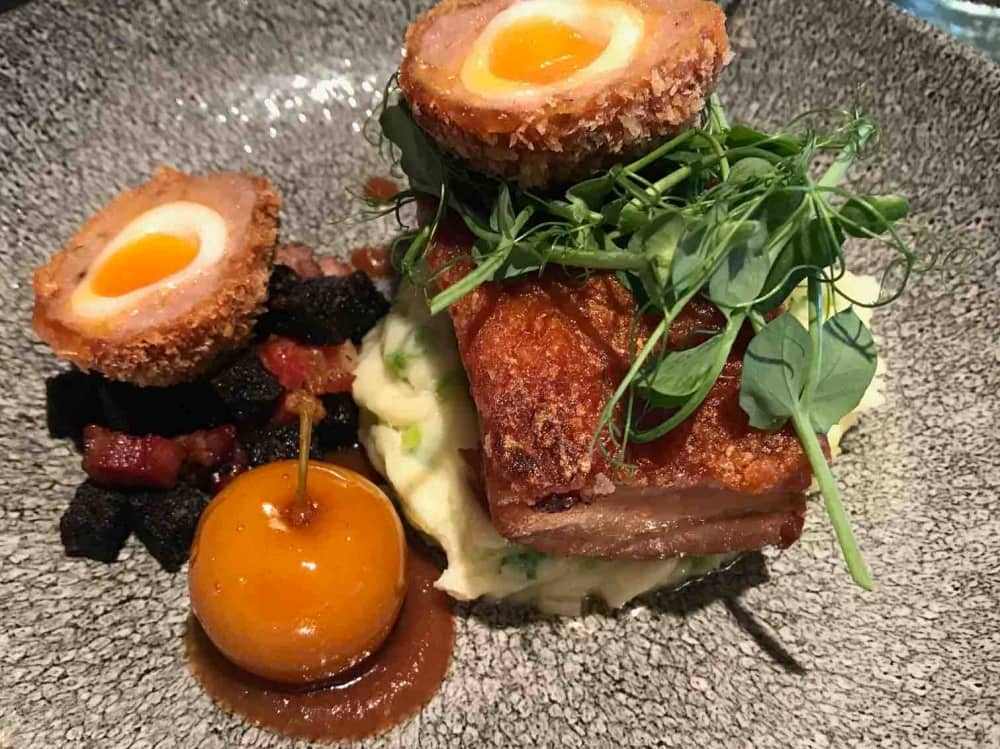 Pulled pork with caramalised apple, wash and scotch egg on grey speckled plate – The Newbury Pub Berkshire