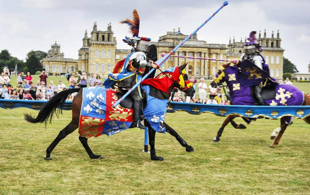 knights on horseback charging in joust contest Blenheim Palace