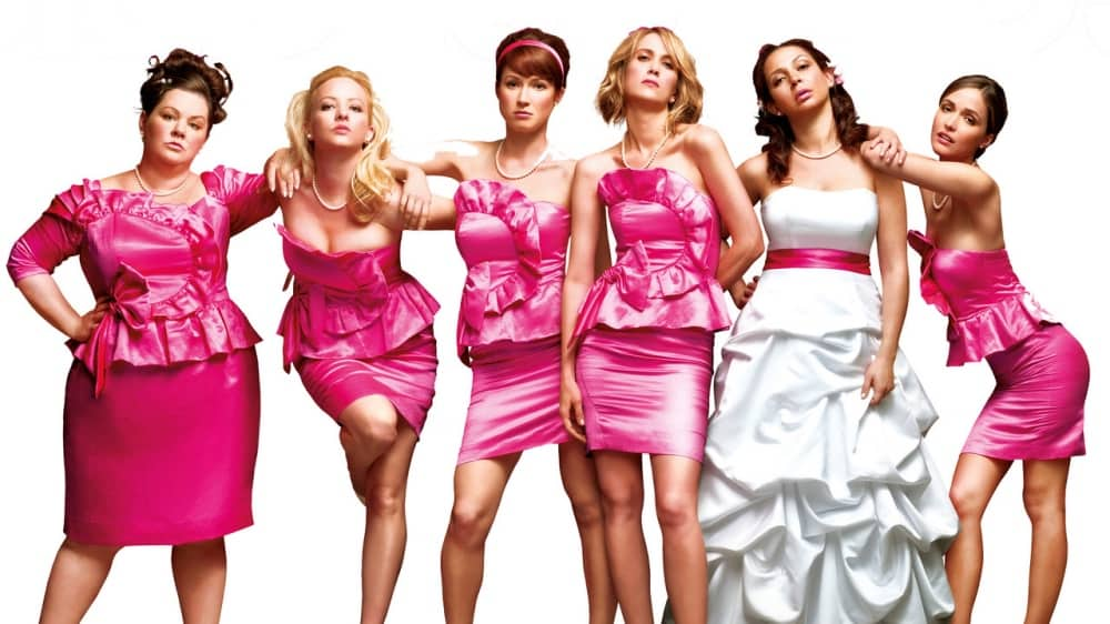 Bridesmaid movie with bride and 5 bridesmaids wearing pink satin short dresses