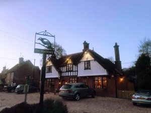 The Blackbird Bagnor exterior with cut out metal pub sign early evening