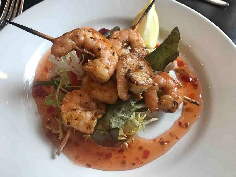 Skewered tiger prawns with salad and sweet chilli sauce The Boatman Windsor