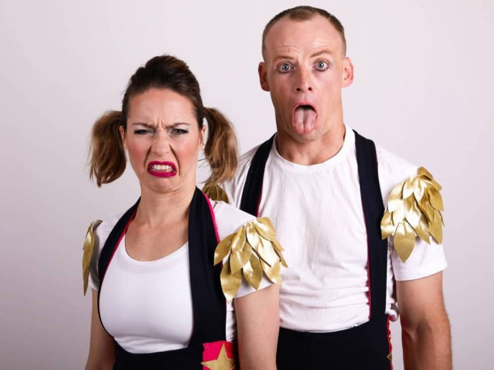 Circus act man and woman pulling faces Children are stinky Norden Farm Maidenhead