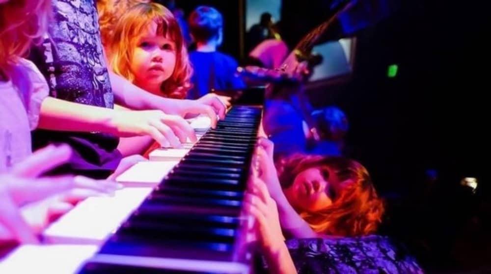 kids playing piano at children's musical concert Concertini Norden Farm Maidenhead