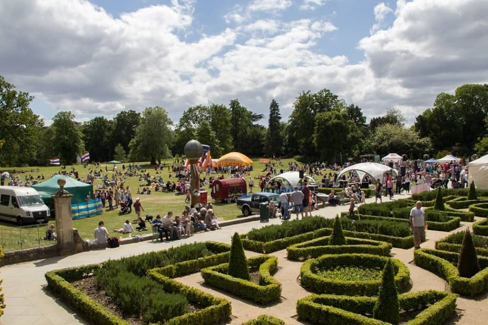 families and people in the grounds and formal garden of South Hill Park Bracknell Festival of food and music