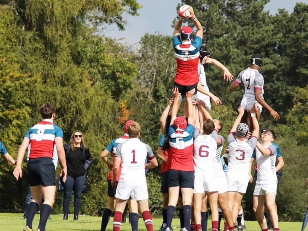 Ruby players pushed into the air for throw in Pangbourne College