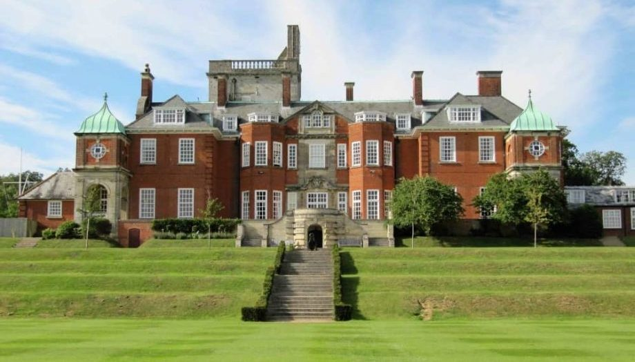Red brick mansion house of Pangbourne College Devitt House Pangbourne Berkshire steps down on the lawn area