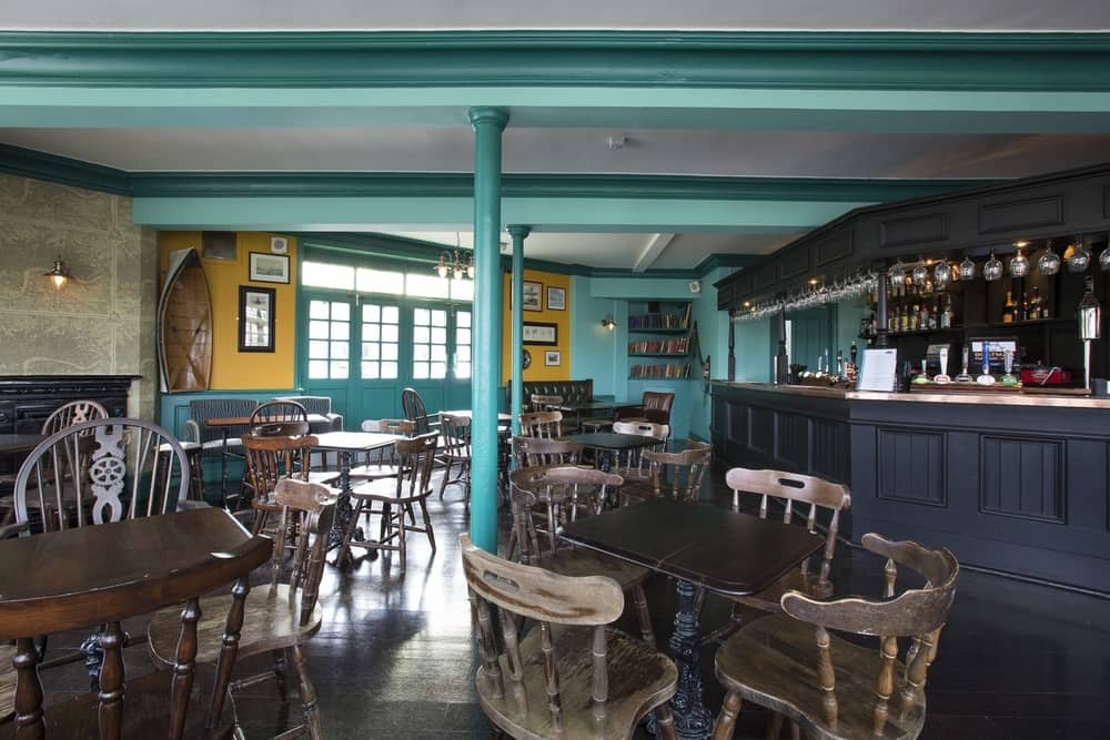 turquoise and yellow walls bar area The Boatman Windsor