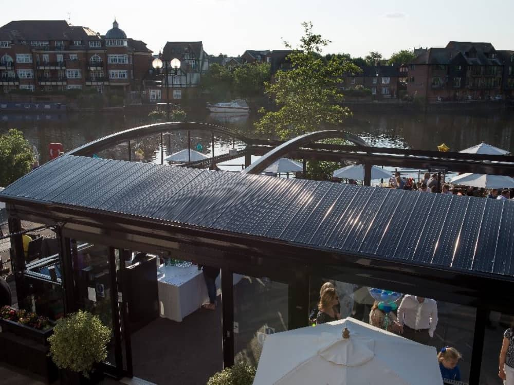 conservatory with retractable roof by river Thames Windsor the Boatman pub