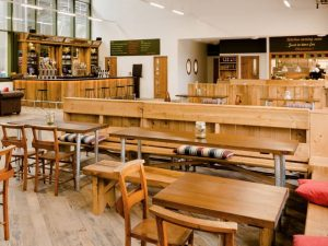 woodener benches and church pew chairs Taproom West Berkshire Brewery Yattendon Berkshire