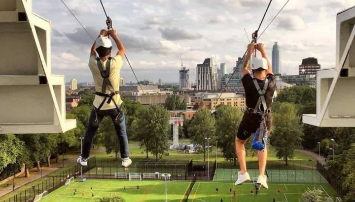 Two people Zipwire over London's South Bank Zip Now London