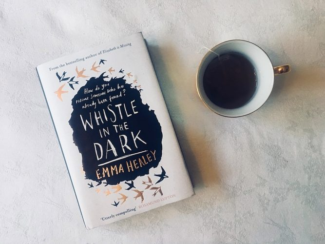 Whistle in the dark book black coffee in white mug with gilded edge