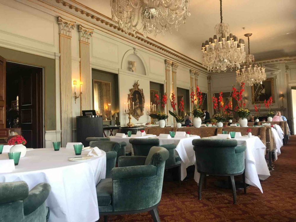 Andre Garrett Restaurant Cliveden House Hotel Art Deco dining room teal velvet, chandeliers and crisp white table linens