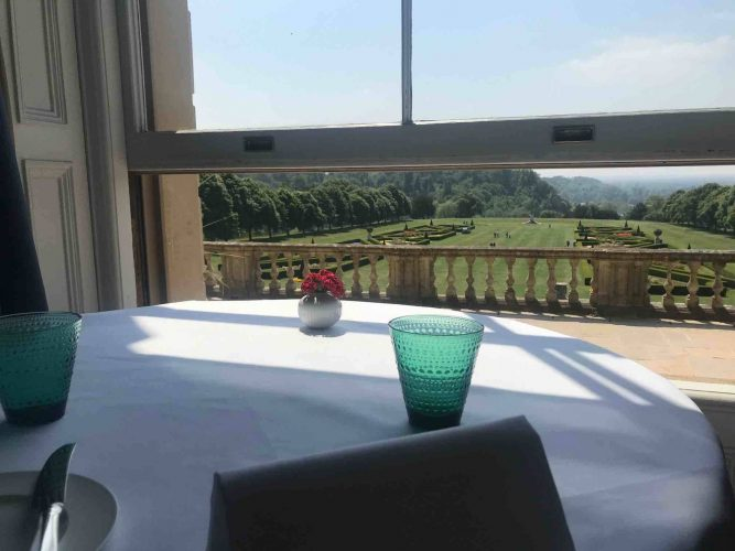 Cliveden House Hotel Andre Garrett restaurant view south Parterre through window with teal water glass and white table cloth