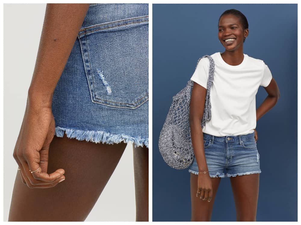 Model in H&M blue denim cut off short white t shirt and net bag blue background