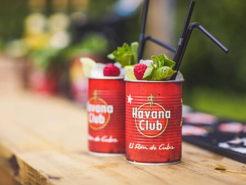 MOJOSECCO COCOKTAILS SERVIED IN HAVANA CLUB TIN CANS AT THE VILLAGE POP UP BAR READING BERKSHIRE