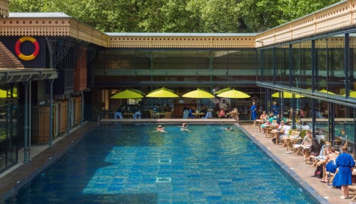 Thames Lido Victorian lido modernised with bright colours. yellow parasols Reading Berkshire
