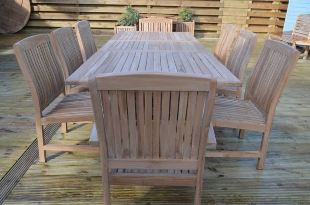 Field and Hawken teak garden dining table with stackable chairs