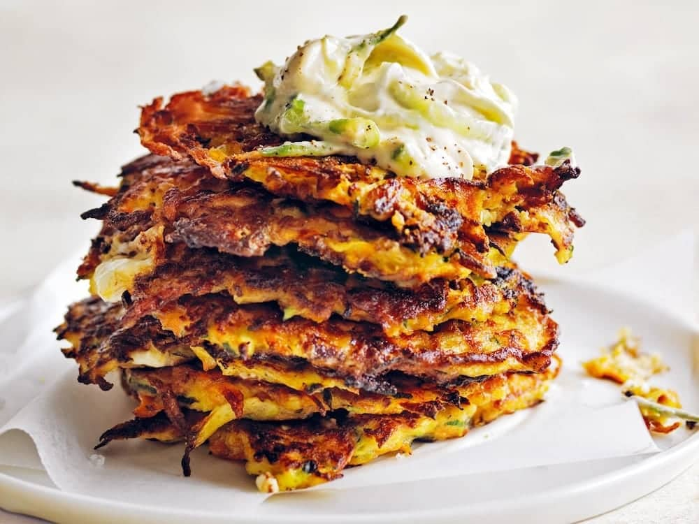 Diana Hay Veggie fritters stacked with cucumber houmus