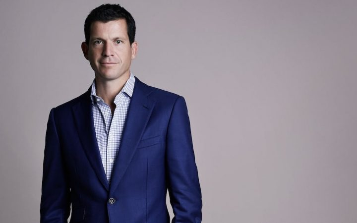 Pro Tennis player Tim Henman blue suit and open pale blue shirt
