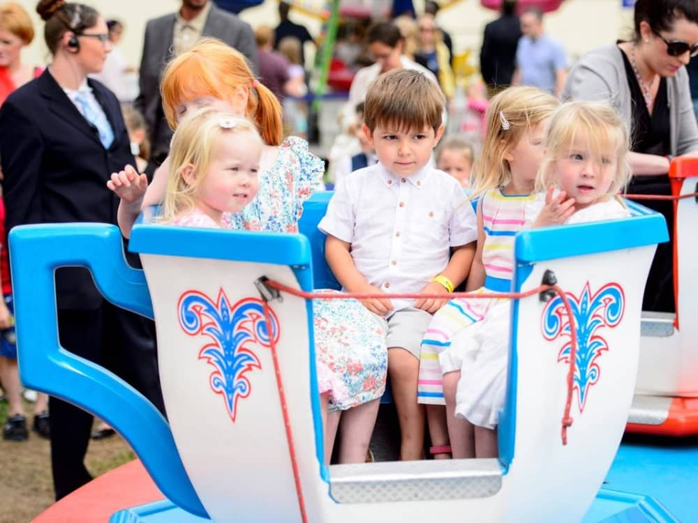 Ascot racecourse kids riding Teacups fairground ride Berkshire