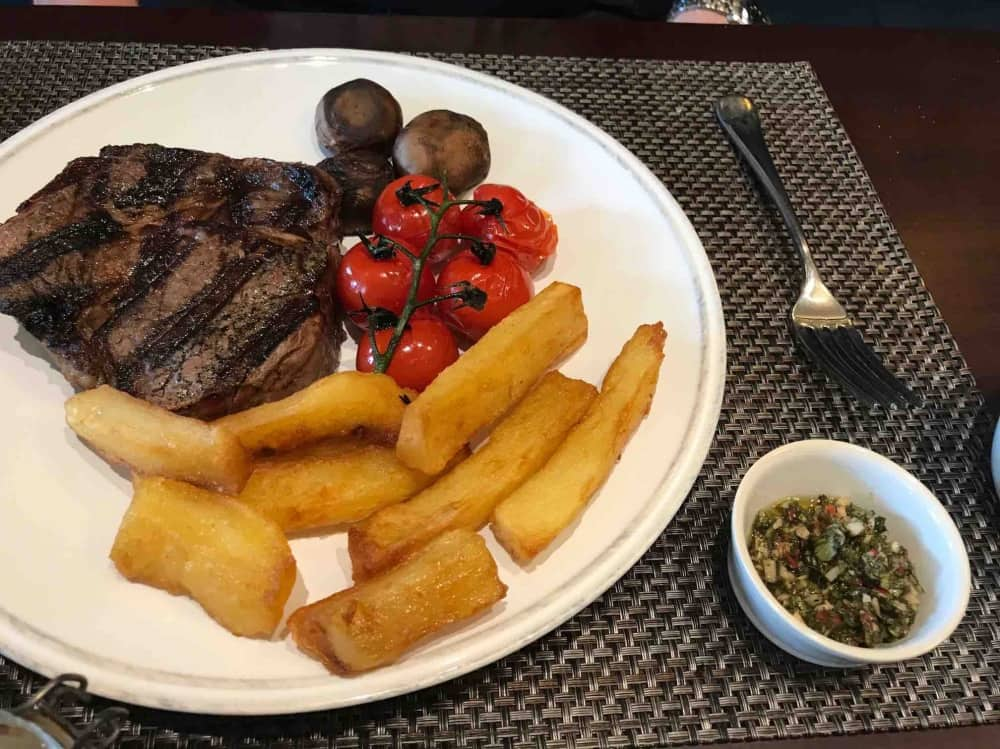 Astor Grill Cliveden House Hotel Ribeye steak tomatoes on the vins mushroom and triple cooked truffle chips chimmchurri sauce