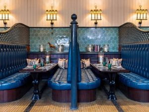 Astor Grill Cliveden House old stables now booths with original green hexagonal tiles, blue leather banquettes and brass light fittings