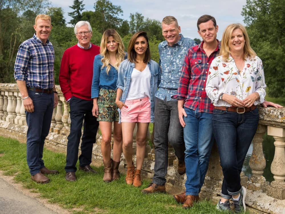 BBC Countryfile Live presenters leaning against Blenheim Palace stone bridge