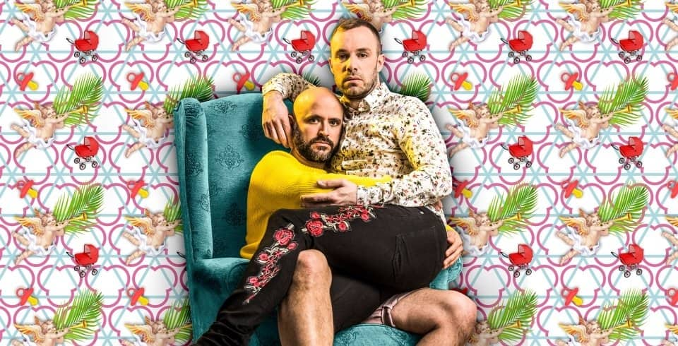 No Kids Theatre production to men sat on lap in armchair hugging