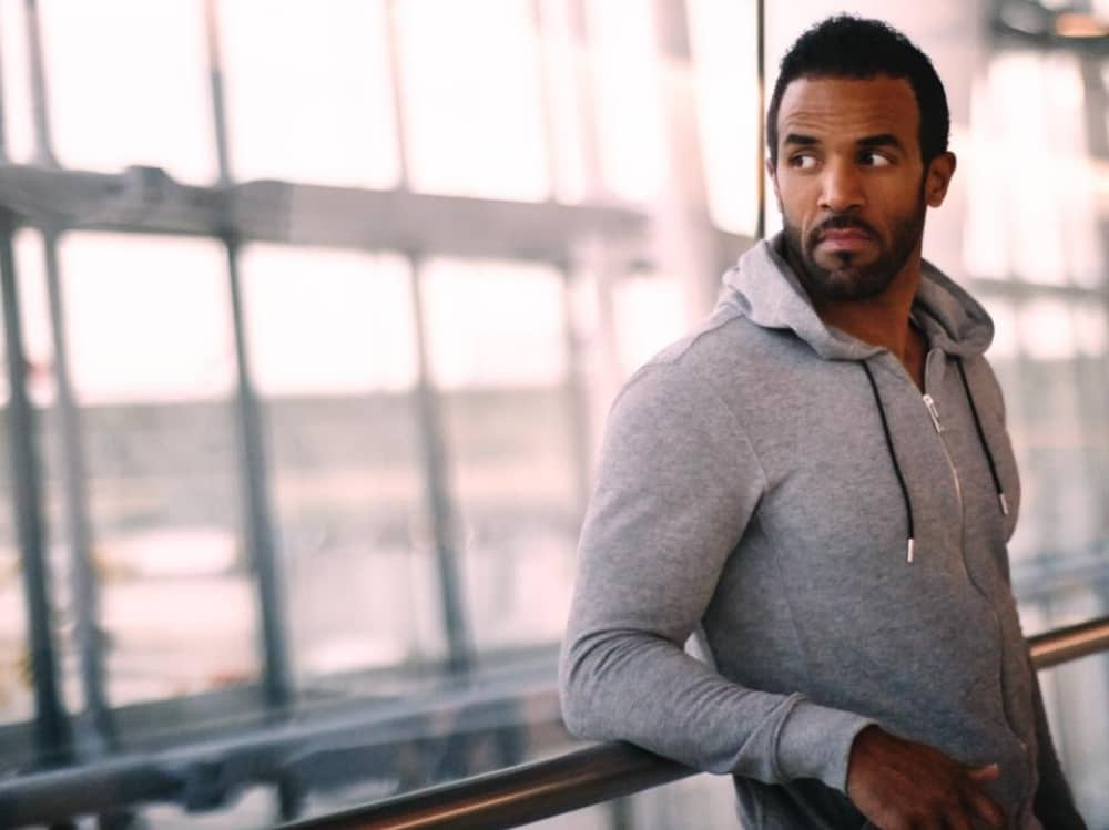 R&B Garage singer Craig David great house beard leaning against railing