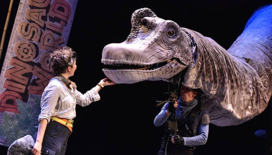 Open Air Theatre Regents Park London Dinosaur World huge diplodocus puppet and boy