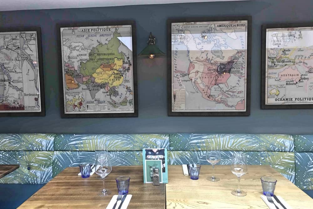 Dolphin Newbury Berkshire palm leaf banquette vintage maps worn pine tables and blue walls