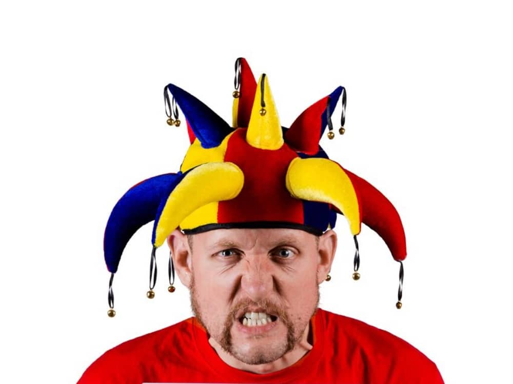 Fringe Festival Big Howard's Yukfest barded man in red jumper jesters hat angry face