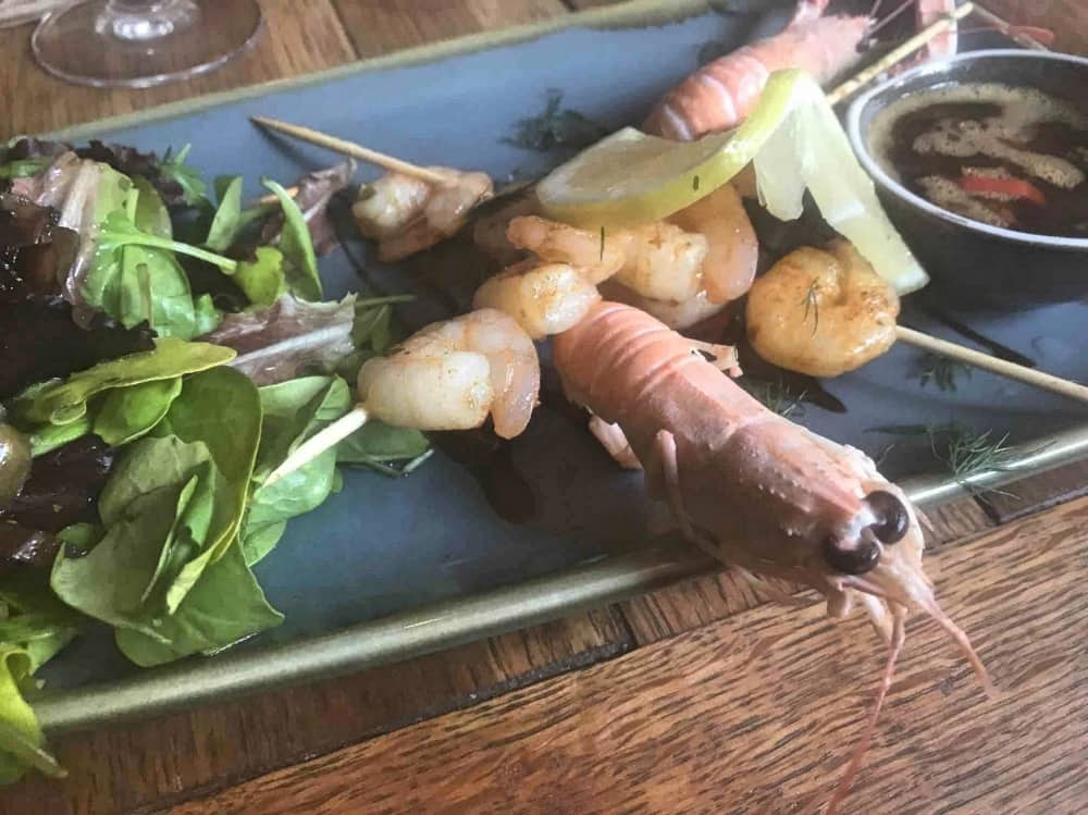 The Jolly Woodman Burnham Slough rectangular blue plate skewered prawns salad and whole king prawns