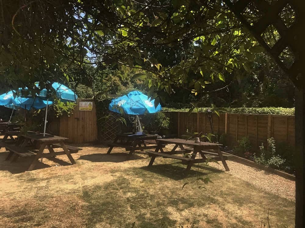 Jolly Woodman Burnham Slough enclosed beer garden blue parasol
