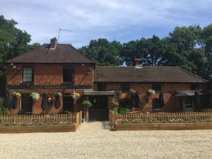 The Jolly Woodman Burnham Slough 19th century rd brick country pub with floral baskets and beds