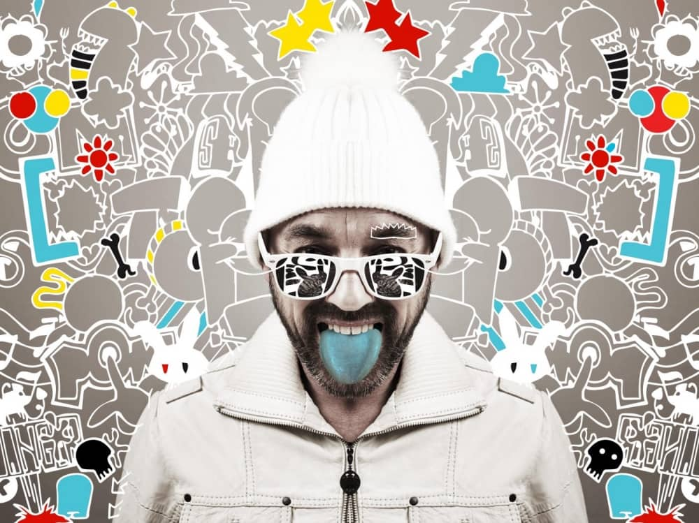 Reading Fringe Festival Seska Spot the Difference bared man in white hoodie and bobble hat with blue tongue surrounded by doodles