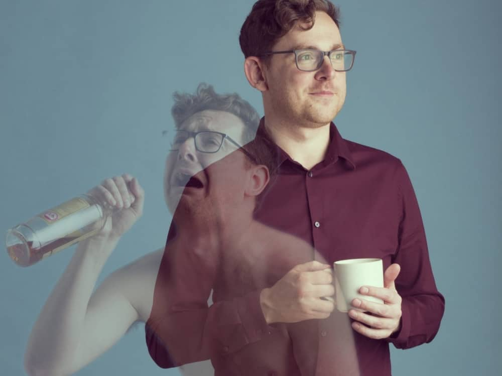 Reading Fringe Jim_Campbell_Trampoline – man in glasses holding mug and blur of him half naked crying swigging spirits out of a bottle