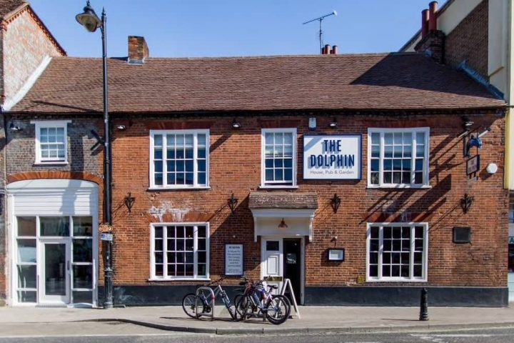 The Dolphin Pub Newbury Berkshire red brick Victorian terrace pub with white framed windows