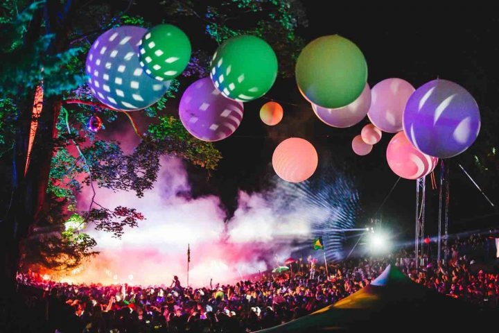 Pink green and purple balls above the crowd at Wilderness Festival Cornbury Oxon