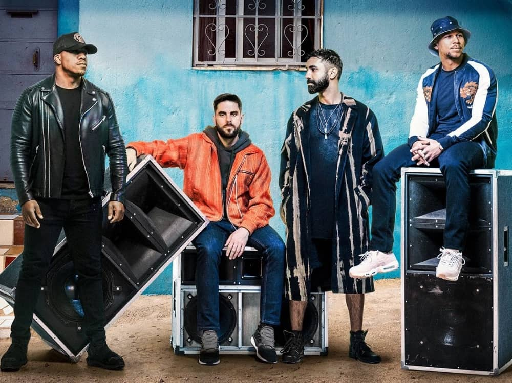 Rudimental band Newbury Racecourse satin speakers blu wall background