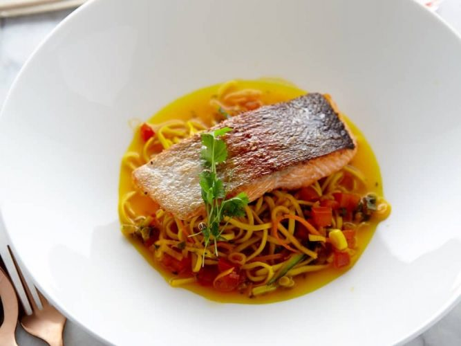 Sea trout noodles speedy supper in a white plate