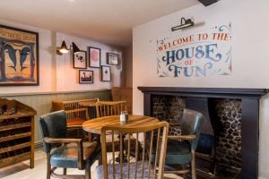 The Dolphin Pub Newbury Berkshire House of fun wall sticker, vintage pub games open fire place and picture gallery on the wall