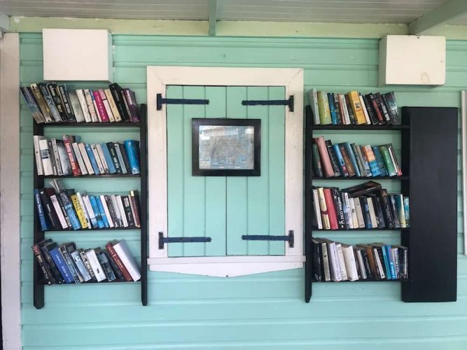 Antiguan house with outside bookshelves full of books