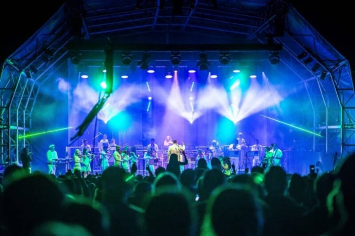 Ibiza orchestra and Ministry of Sound stage with blue and green lighting and dancing crowd