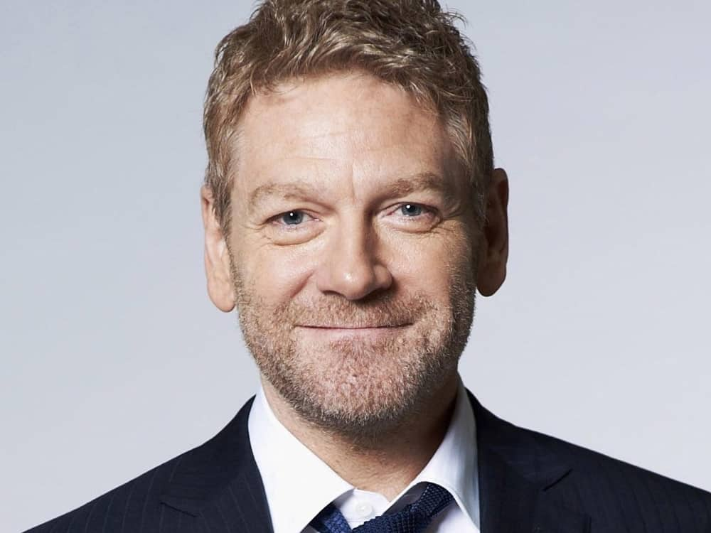 Actor Kenneth Branagh sponsor Windsor Fringe Festival New Writers Awards wearing navy suit and loose tie