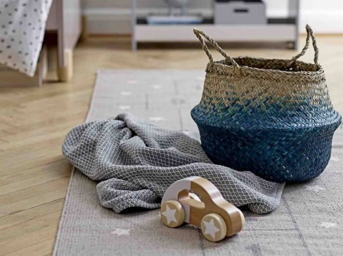 Turtle Dove Living Rattan basket with blue ombre bottom grey star rug and wooden car and grey blanket